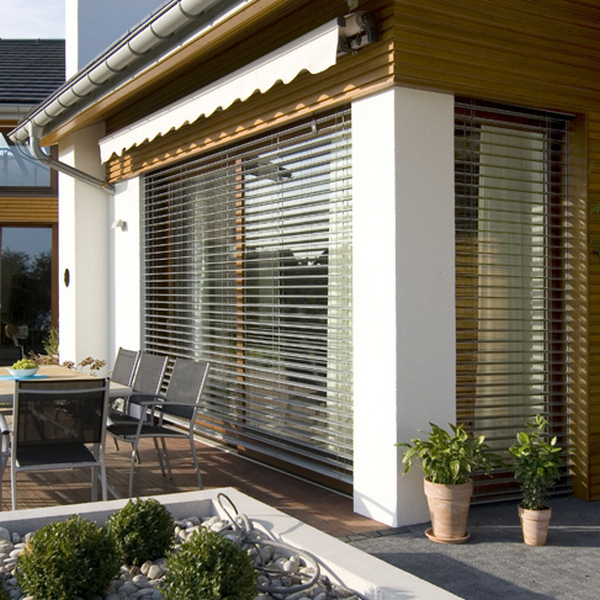 closed rolled up awning private house terrace and pool facade ideas