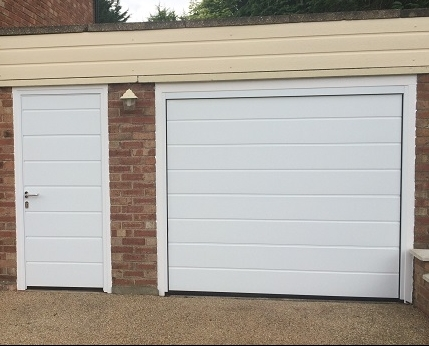 white automatic garage door centre ribbed panels and white side door comfort private garage