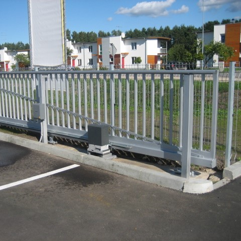big grey metallic sliding gates with automation parking lot