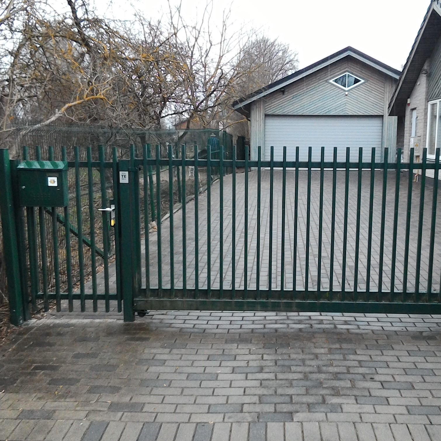 dark green classic metallic sliding gates with automation custom made