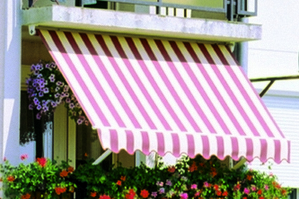 traditional red and white striped awning for a balcony