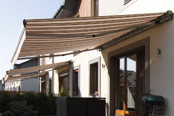 modern striped sun awning for summer shade in private house garden